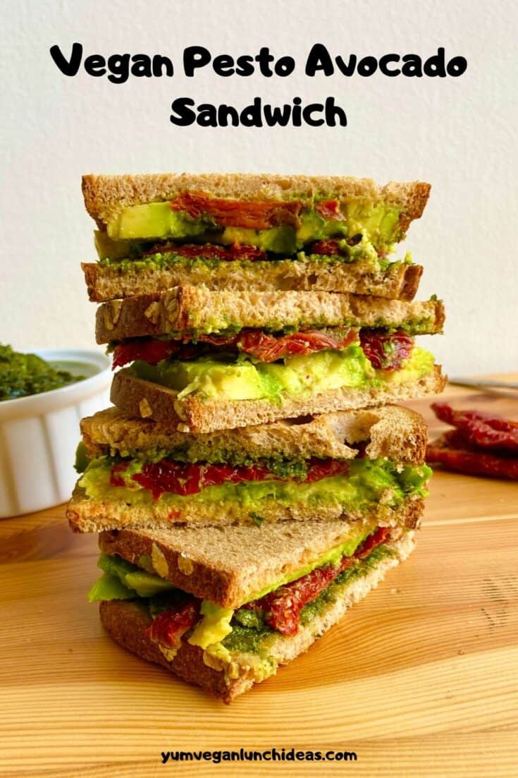 This vegan avocado sandwich is the perfect cold vegan sandwich for packed lunches, quick breakfast, or anytime you want some creamy avocado goodness. It comes together in just a few minutes but feels so much more indulgent then a classic avocado sandwich. It's also plant based and travels well! | Vegan Avocado Recipes | Vegan Pesto Recipes | Vegan Recipes with Pesto | Vegetarian Avocado Sandwich | #yumvegan #avocado #avocadosandwich #pesto #veganpesto #vegansandwiches