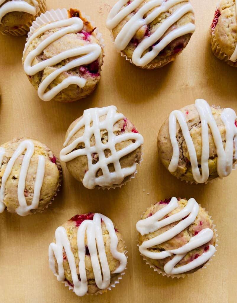 vegan raspberry muffins with vegan cream cheese topping